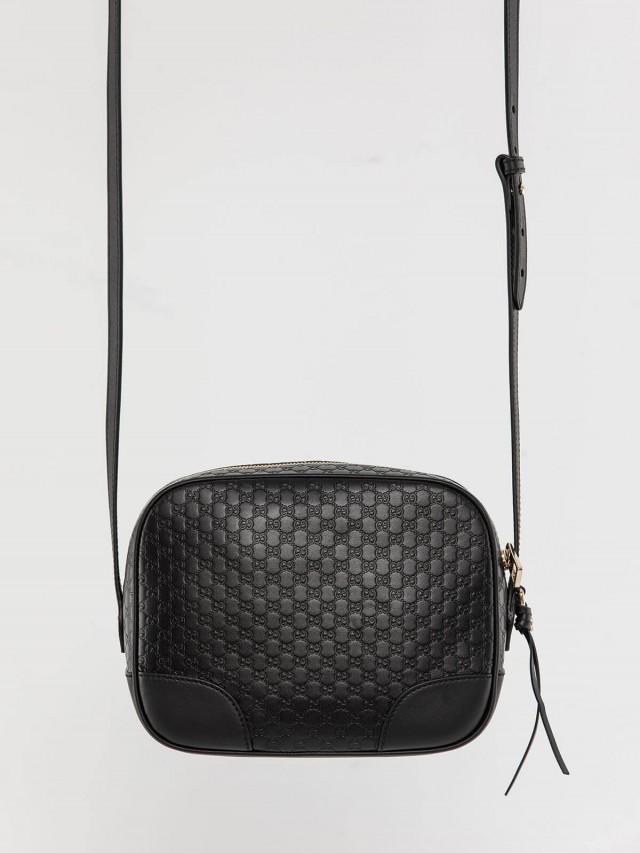 GUCCI Soho Disco 牛皮壓紋雙 G 側邊金屬吊飾斜背包 - 黑色